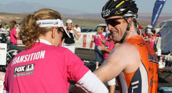 A volunteer applies sunscreen to an Ironman competitor at T1, the transition from the swim to bike course, on May 7, 2011, at Sand Hollow State Park. | Photo courtesy of St. George Iron Man.