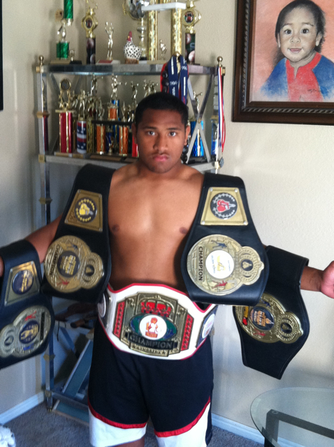Pano Tiatia boasting five championship belts from wins in the Junior Golden Gloves, St. George, Utah, date not provided | Photo courtesy of Pano Tiatia