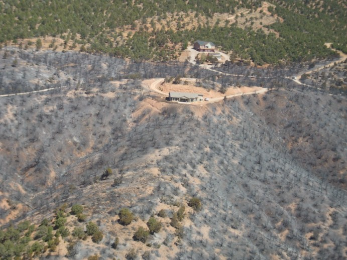 """An aerial photo taken on June 29 by Nick Howell illustrating the importance of """"defensible space"""" when living in what is called the Wildland Urban Interface. Howell said vegetation treatments conducted by BLM and Forestry, Fire and State Lands made a big difference in the overall outcome of limiting this fire's path of travel.  Defensible space on private property and vegetation treatments on State and BLM land were a great combination here. June 29, 2012 