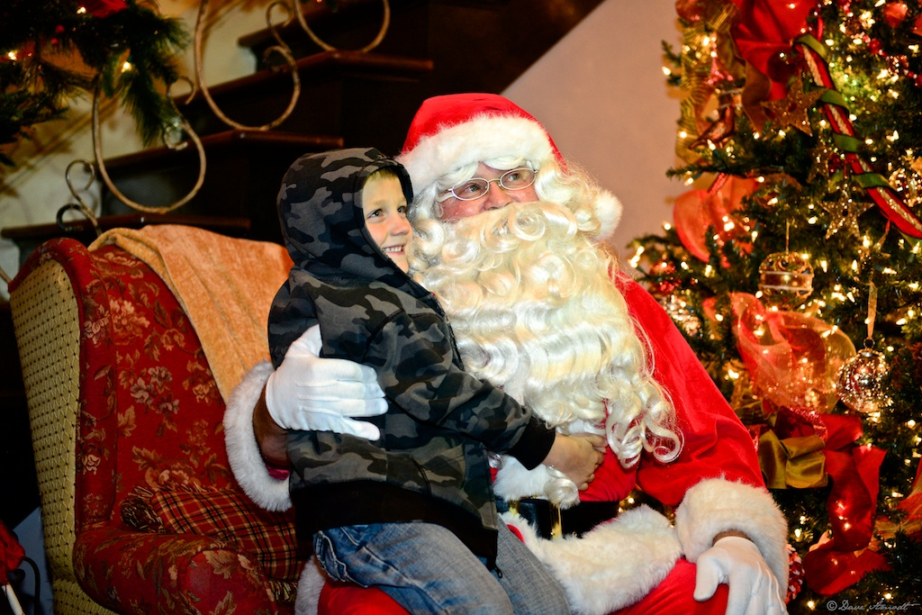 Brigham Kemp 5, visits with Santa at the Covington Mansion.