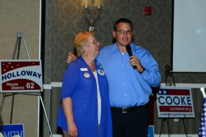 L to R: Washington County Democratic Party Chair Dorothy Engelman  with Chris White, candidate for county commissioner, conceding.