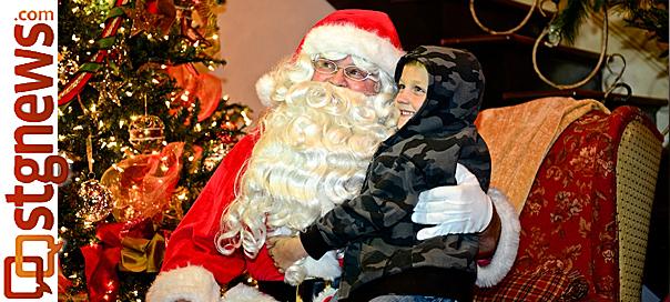 Santa with Brigham Kemp, 5, Christmas comes to Dixie