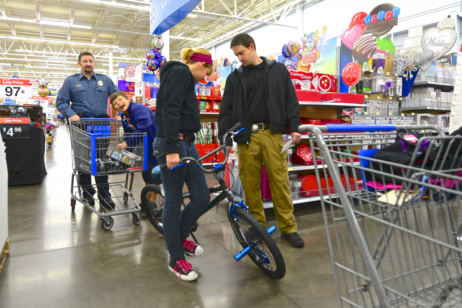 Adult Parole and Probation officer Daniel Cox helps Charlee Morrow with a new bike purchase.