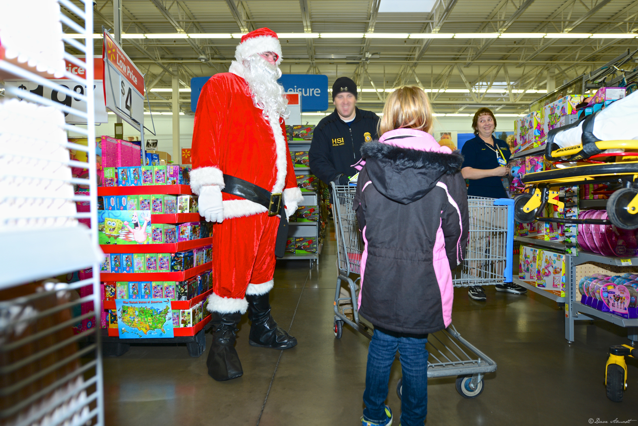 Santa Claus, young shopper and a cop
