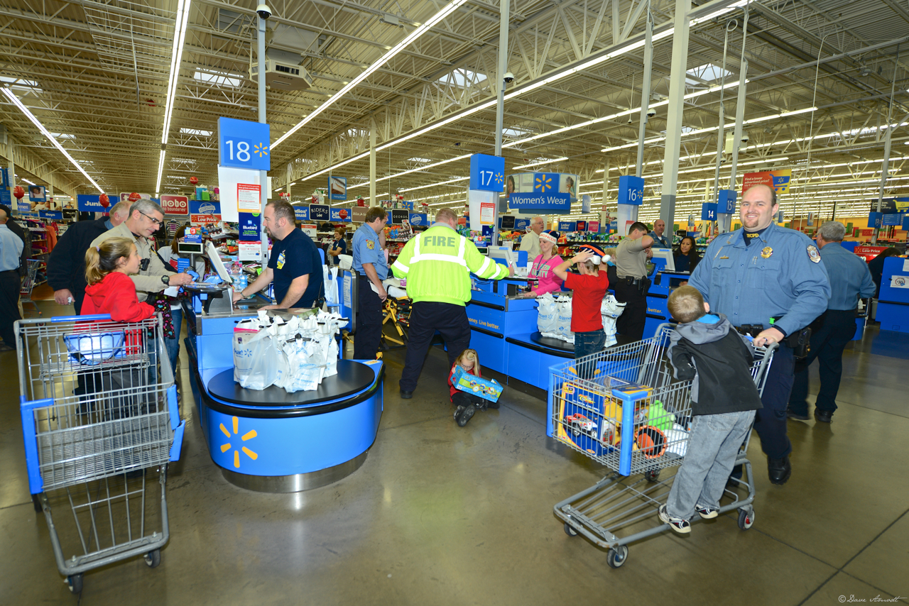 Wal-Mart workers start their Saturday morning checking out the Shop with a Cop