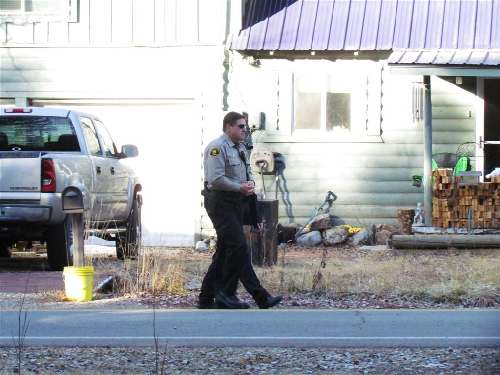 Law enforcement security outside the home of Mark Redwine