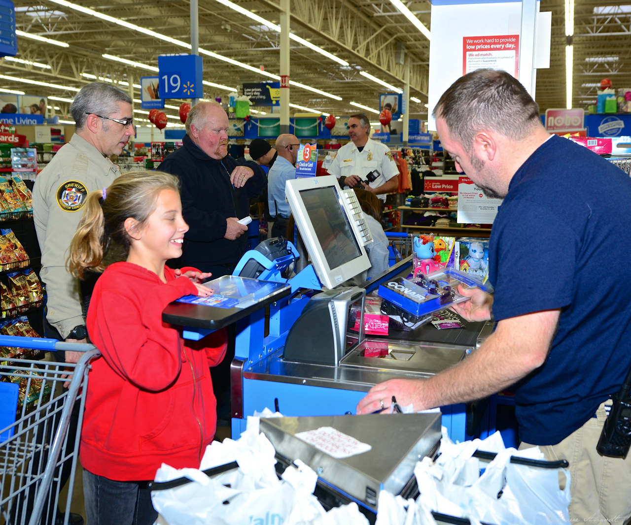 Rayna Rasmussen with Sheriff's Officer Eric Endter checking out.