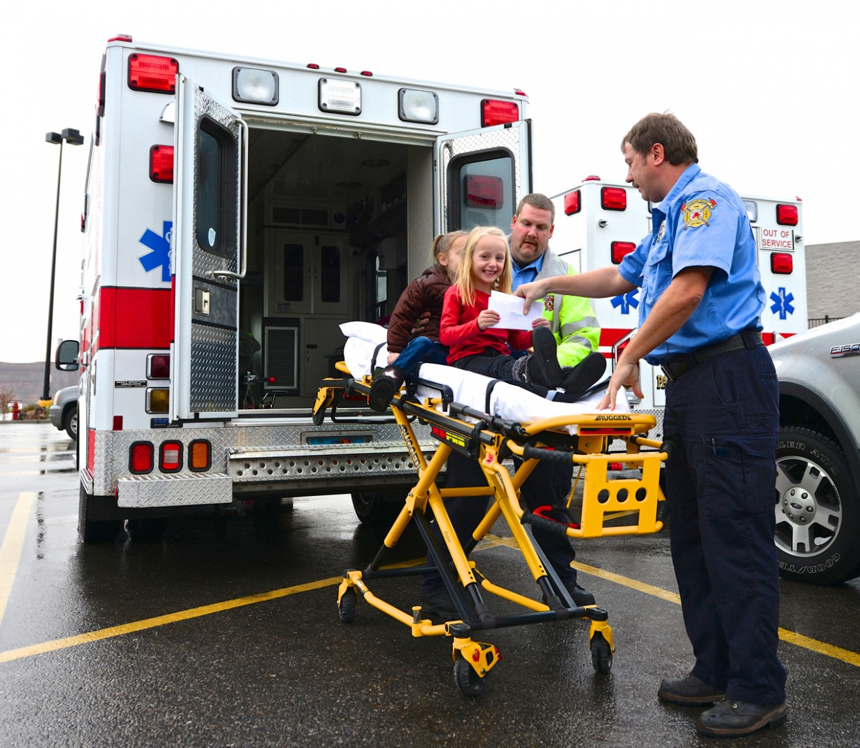 The Barlow sisters arrive at Hurricane Wal-Mart via Hurricane Ambulance for Shop with a Cop event  2012.