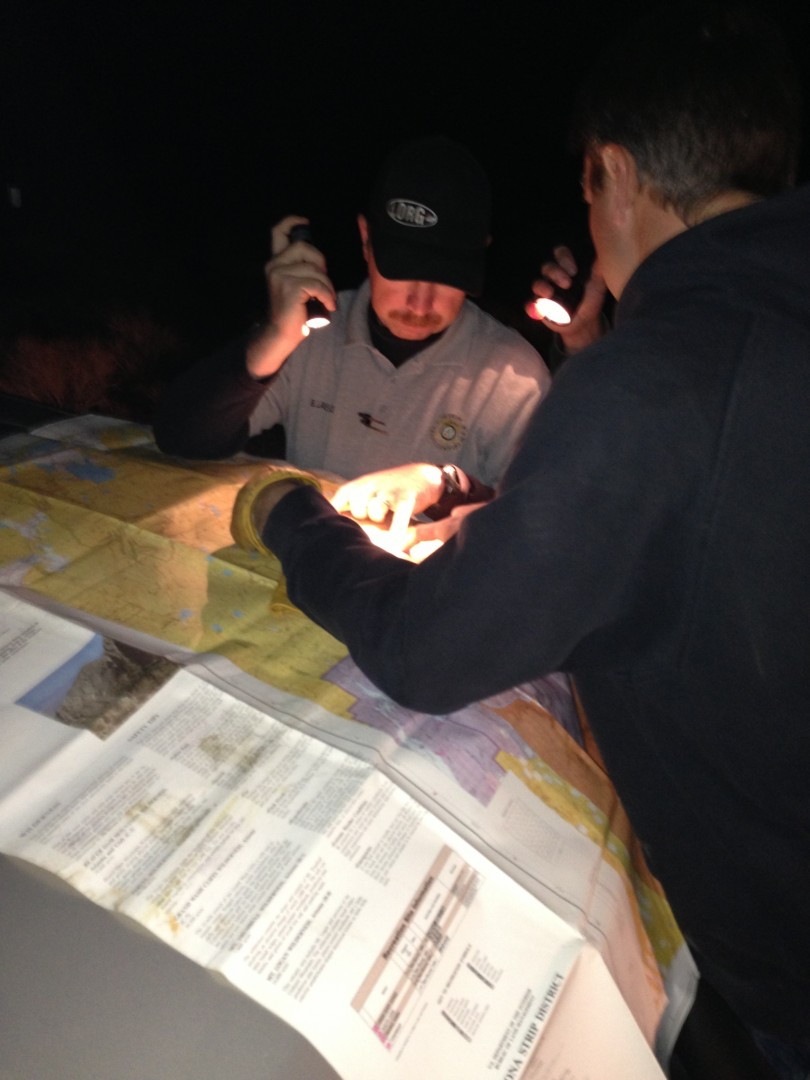 Bar 10 Ranch owner Gavin Heaton showing Mohave County Search and Rescue Team on their map  the location that the arrows were spotted which ultimately led SAR to Matt Telford, Arizona Strip, Ariz. Feb. 10, 2013 | Photo by Heather Lewis, St. George News