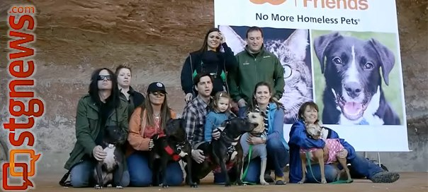 "Six adoptive families and their ""Vicktory dogs,"" so-named for rescue from the Michael Vick dogfighting organization indicted in 2007, reunite at Best Friends Animal Society's Angel's Landing for a media display of recovery, rehabilitation and hope. Kanab, Utah, March 11, 2013 
