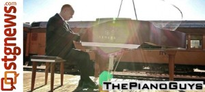 The Piano Guys filming a music video on top of a moving train | Photo courtesy of The Piano Guys