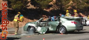 A woman was taken to the hospital after being cut out of her car on Red Cliffs Drive by emergency responders, St. George, Utah, March 11, 2013 | Photo by Mori Kessler, St. George News