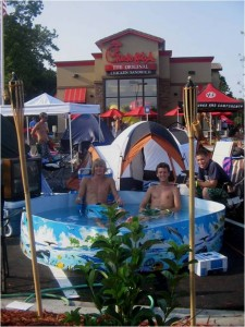 sample parking lot tent shot with pool for cfa grand opening