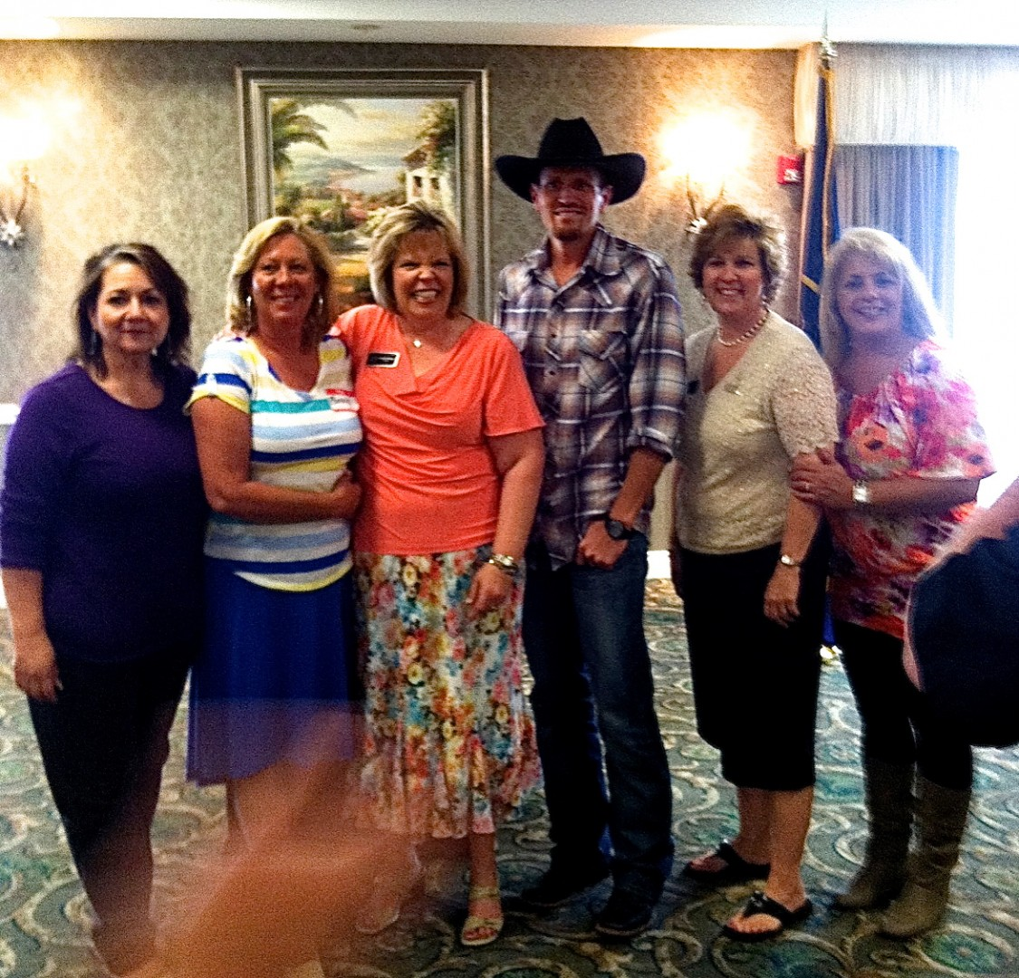 """L to R: Lil Barron (ret. Workers Compensation Fund), Bonnie Pendleton (The Plant Lady), Debbie Hofhines (Woman of the Year 2013), Eric Dodge (Country Music Artist), Julie Williamson (Woman of the Year 2012; Morris Murdock Travel), and Nina Heck (Oh My Heck Marketing). Utah Business Women """"Woman of the Year"""" award luncheon, Abbey Inn, St. George, Utah, April9, 2013 