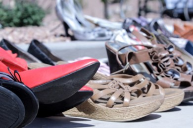 """1497127f7e0 Men and boys gather to strap on high heels at the """"Walk a Mile in Her Shoes  International Men s March Against Domestic Violence and Sexual Assault  event"""