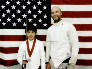 UFA coach Parker Miner (right) poses with Youth 14 Foil event gold medalist Raphael Pinna at the Desert Blades Youth Tournament in Las Vegas | Photo courtesy UFA