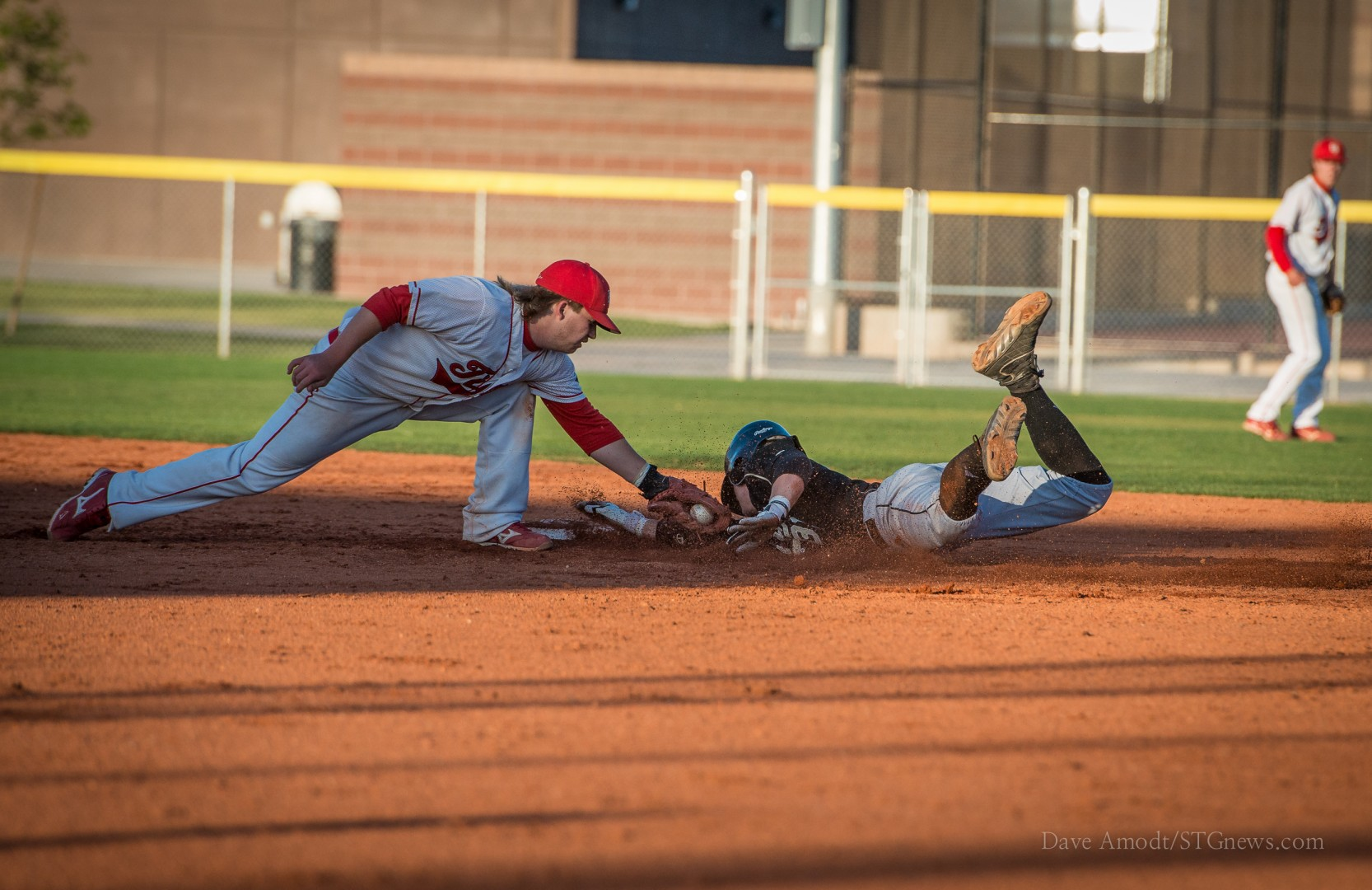 Ben Parker makes a tag on Ty Rutledge Friday night, Desert Hills at Hurricane, Hurricane, Utah, May 3, 2013 | Photo by Dave Amodt, St. George News