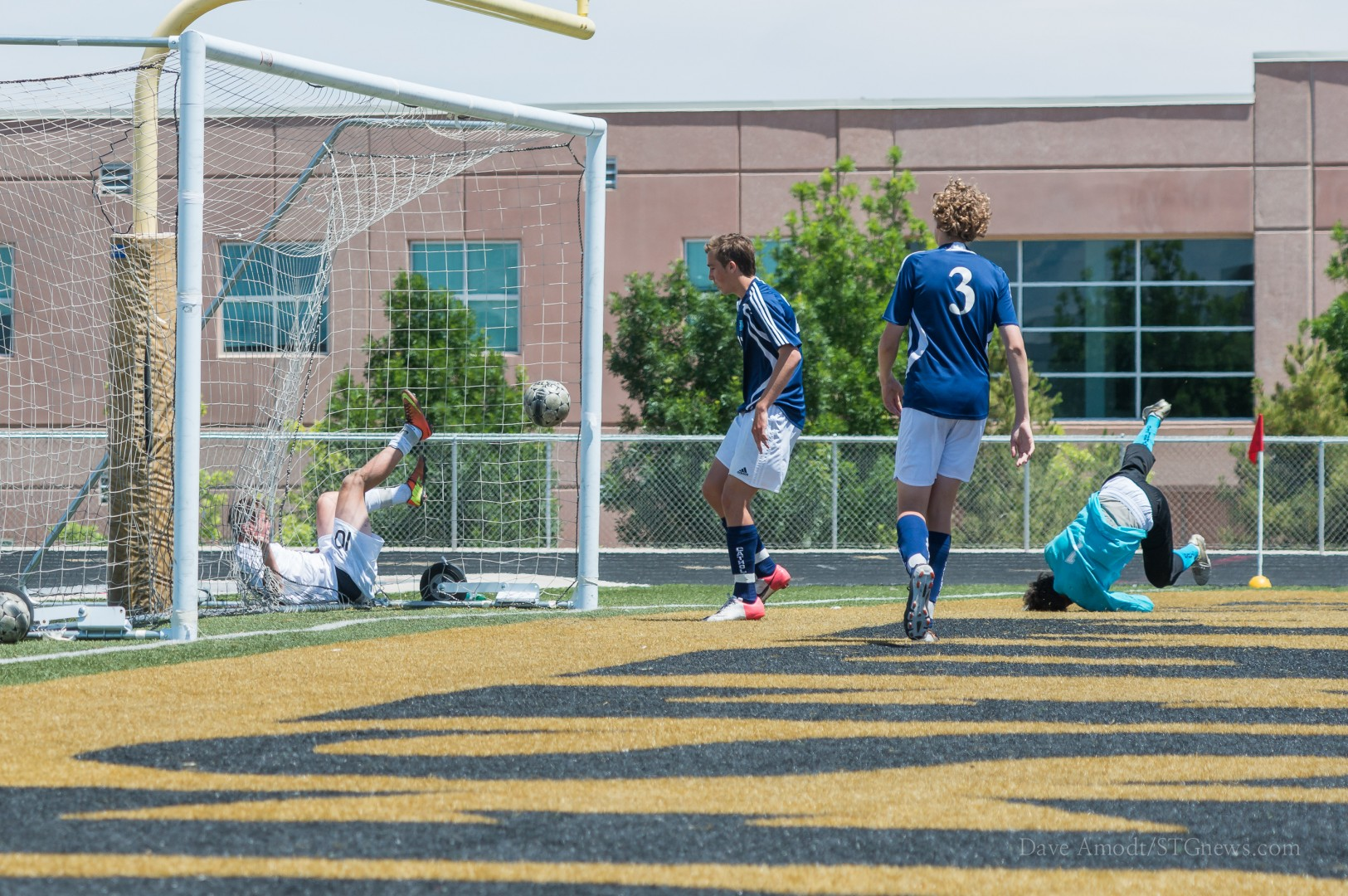 DH's Brock Johnson ends up in the net after scoring a goal Saturday, Juan Diego at Desert Hills, St. George, Utah, May 4, 2013   Photo by Dave Amodt, St. George News