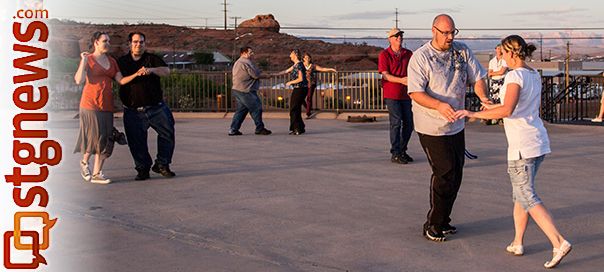 People gather atop the water tower on the Red Hill overlooking St. George for dancing and dance lesson, St. George, Utah, May 28, 2013 | Photo by Chris Caldwell, St. George News