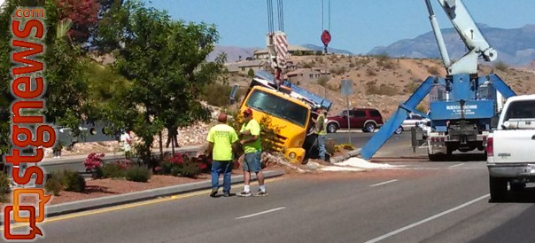 It took two cranes to lift an asphalt truck ran into the median on Dixie Drive and got wedged in place, St. George, Utah, May 30, 2013 | Photo by Mori Kessler, St. George News