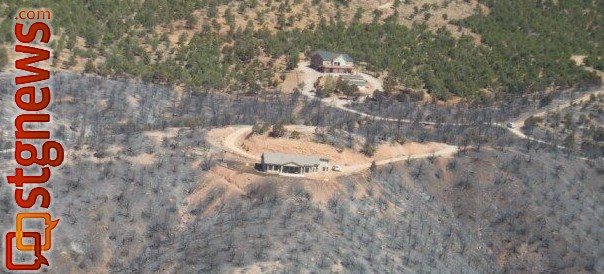 "An aerial photo taken on June 29 by Nick Howell illustrating the importance of ""defensible space"" when living in what is called the Wildland Urban Interface. Howell said vegetation treatments conducted by BLM and Forestry, Fire and State Lands made a big difference in the overall outcome of limiting this fire's path of travel.  Defensible space on private property and vegetation treatments on State and BLM land were a great combination here. June 29, 2012 