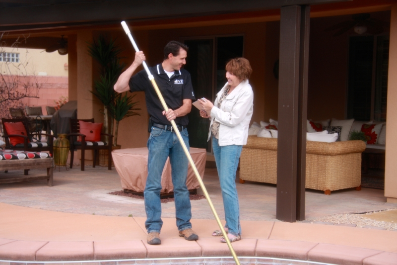 VIP Home Management Services owner, Ryan Barton, assisting a customer, St. George, Utah, April 2013   Photo by Melynda Thorpe Burt, St. George News