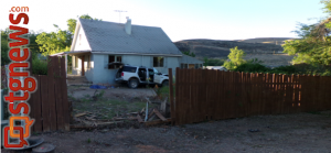 Vehicle hit-and-run at 150 East 600 North, driver crashed through the fence and against the house and abandoned the vehicle. Hurricane, Utah, June 26, 2013 | Photo by Christina DeMille, St. George News