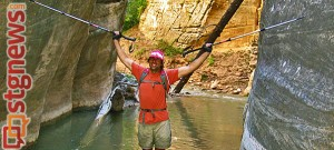 Blind adventurer Erik Weihenmayer hiking through the Zion Narrows. The entrance to the Narrows has been protected by the Trust for Public Land. Zion National Park, Utah, date not provided   Photo courtesy of The Trust for Public Land, PRNewsFoto
