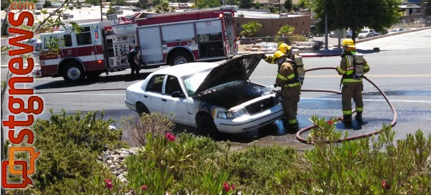 Firefighters finish extinguishing a vehicle on 1000 East just below the St. George Boulevard intersection, St. George, Utah, June 17, 2013 | Photo by Mori Kessler, St. George News