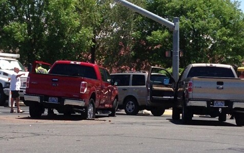 A collision between a white passenger car and a red pickup impacted traffic at the 100 South and River Road intersection, no injuries were reported, St. George, Utah, June 10, 2013 | Photo by Scott Young, St. George News
