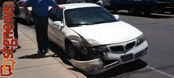 A collision between a white passenger car and a red pickup impacted traffic at the 100 South and River Road intersection, no injuries were reported, St. George, Utah, June 10, 2013 | Photo by Mori Kessler, St. George News