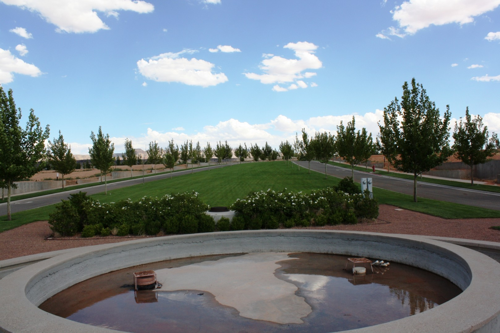 A nearly-empty fountain greets prospective home buyers in Elim Valley's tree-lined streets, July 29, 2013 | Photo by Reuben Wadsworth, St. George News.