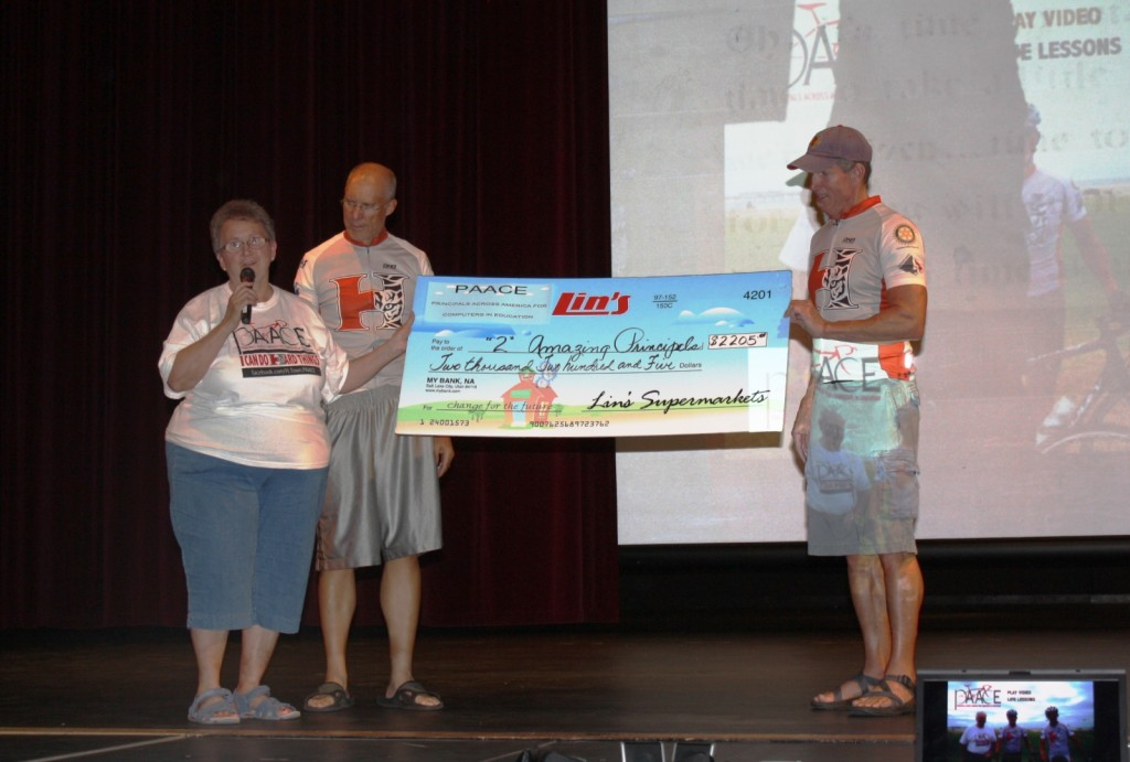 """Lin's Marketplace in Hurricane presents a check for $2,205 to """"Two Amazing Principals;"""""""