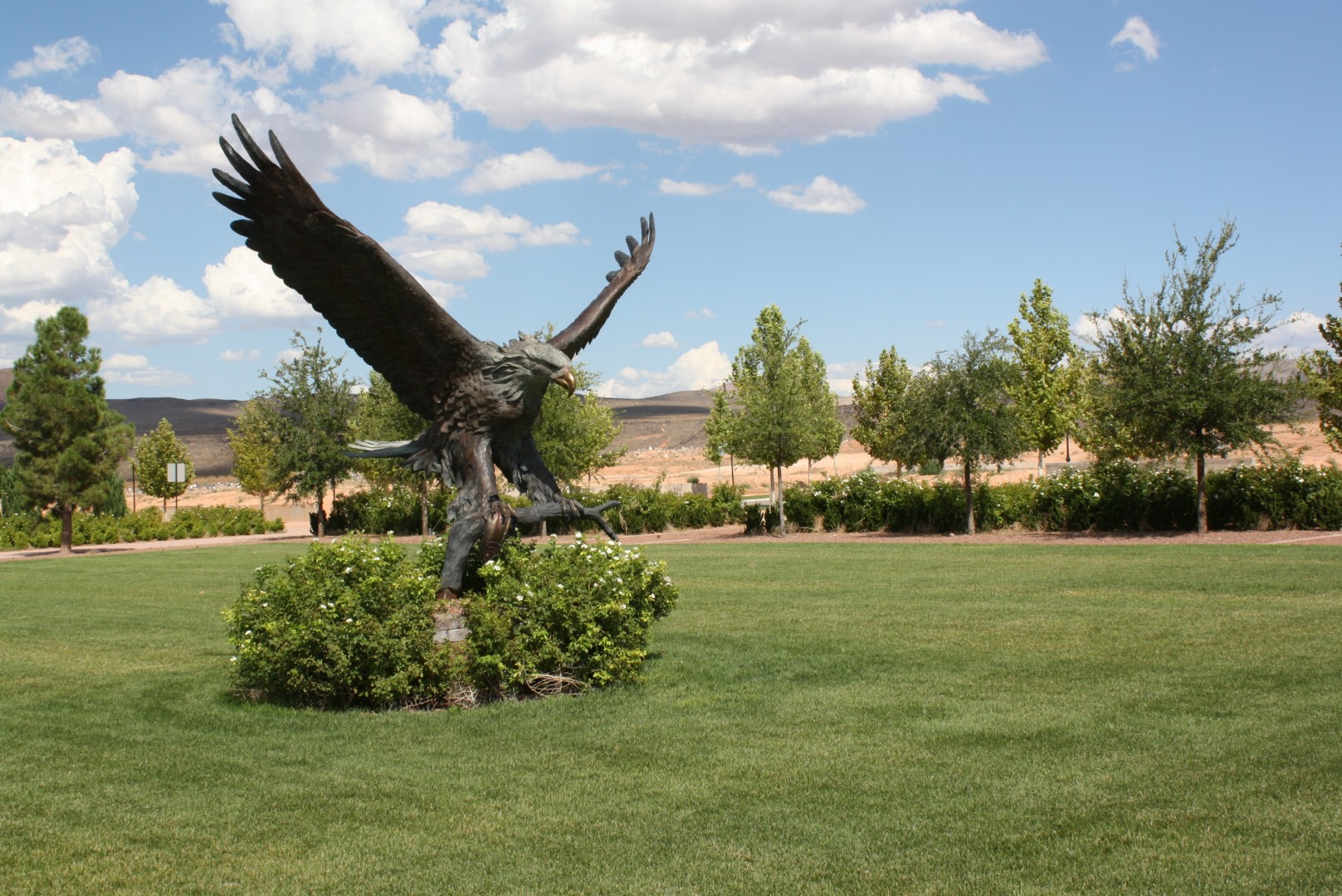A large eagle statue and an expanse of grass will await future homeowners in Hurricane residential development, Hurricane, Utah , July 29, 2013 | Photo by Reuben Wadsworth, St. George News