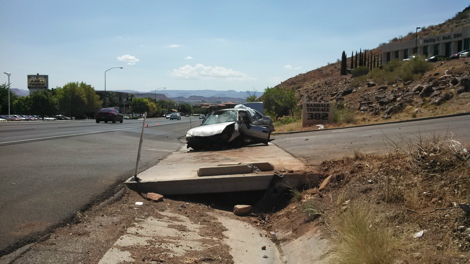 Rollover On Bluff Street Pins Driver In Car St George News