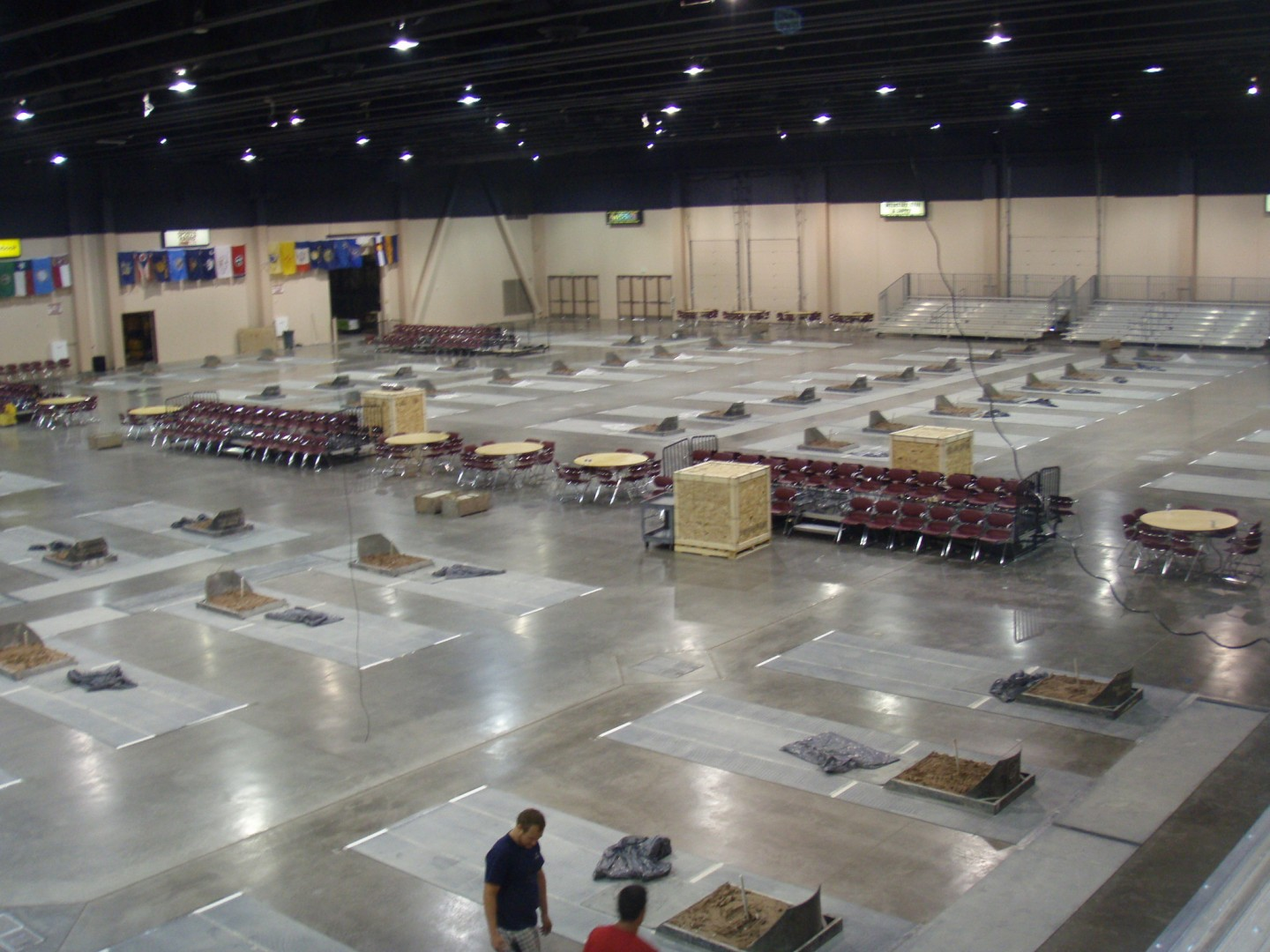 Workers busily transform the Dixie Convention Center into the world's largest horseshoe pit for the World Horseshoe Pitchers Championship now through Aug. 3, St. George, Utah, July 22, 2013. | Photo courtesy NHPA.