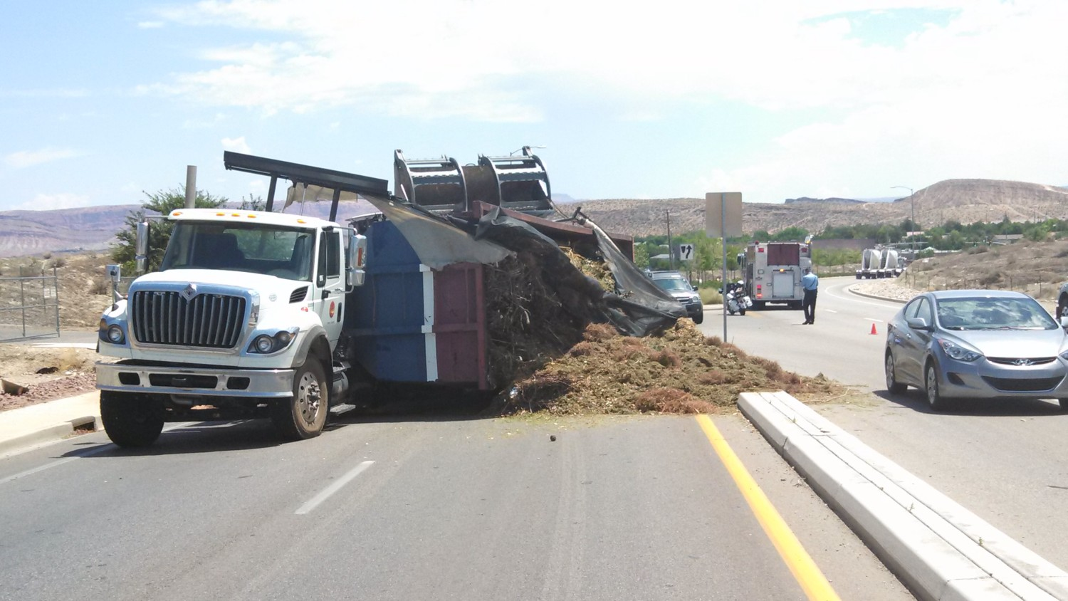 A truck blocks part of Brigham Road after the load of compost it was hauling spills across the roadway, St. George, Utah, July 26, 2013 | Photo by Mori Kessler, St. George News
