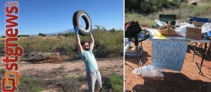 A volunteer triumphantly displays a tire he found alongside the trail, St. George, Utah, Sept. 21, 2013 | Photo by Zach Windsor, St. George News