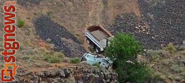 Dump truck goes off the road and off a 40-foot embankment, Utah, Sept. 5, 2013 | Photo courtesy of Ellie N. Olinger, St. George News