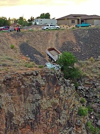 Dump truck goes off the road and off a 40-foot embankment, Hurricane, Utah, Sept. 5, 2013 | Photo courtesy of Ellie N. Olinger, St. George News