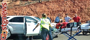 Paramedics respond to an accident at the intersection of Red Cliffs Blvd. and Skyline Dr.