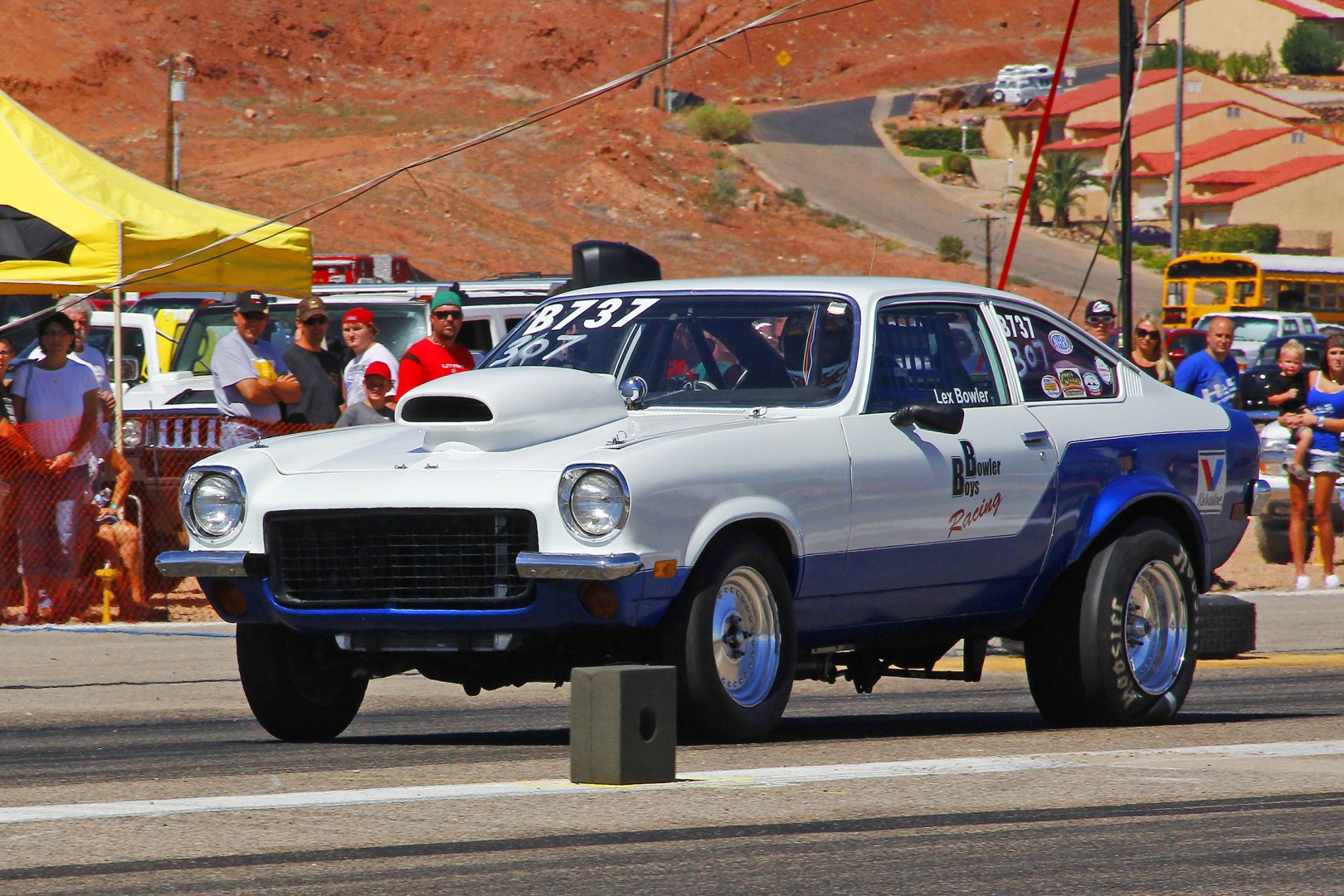 FILE - Lex Bowler, one of the old school drag racers here in St. George, puts the squat on those Hoosier tires as he launches his 1972 Chevy Vega. BlackRock Motorsports Drag Race, old airport St. George, Utah, Sept. 21-22, 2013 | Photo by John Teas, St. George News