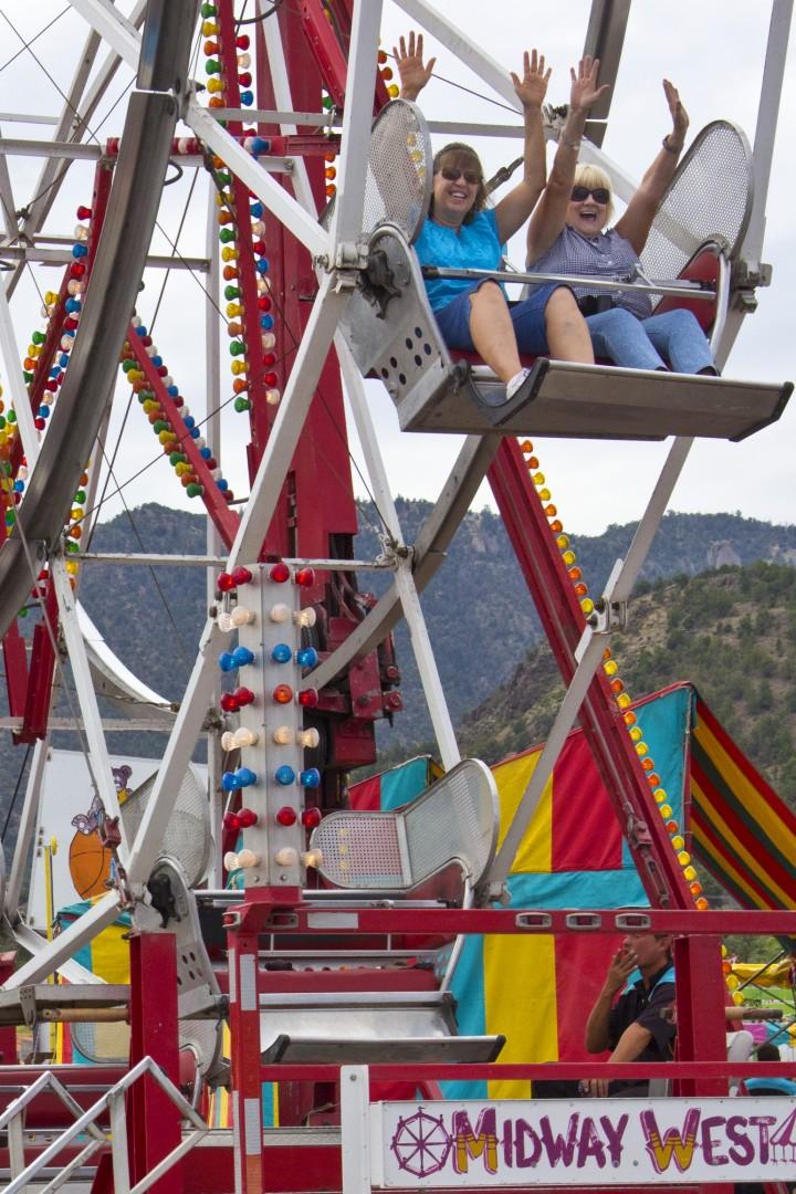 "L-R: Susan Barker, Carol Duhamell. ""Who says these ride are just for kids?"" they said. Iron County Fair, Parowan, Utah, Aug. 31, 2013 | Photo by John Teas, St. George News"