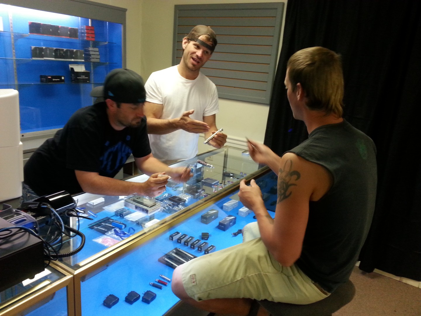 L-R: Owners Tysen Johnsen and Brendon Gunn helping customer at Cloud 9 Vapor in Washington City, Utah, Sept. 30, 2013 | Photo by Drew Allred, St. George New