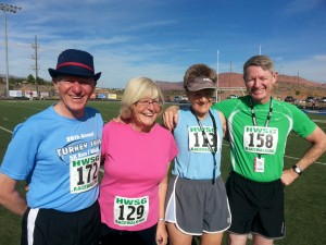 L to R: Daryl Meyers, Kerstin Meyers, Mary Gilbert, Bill Emslie, friends from a power walking club in Brighton, Colorado pose for pictures after their race. St. George, Utah, Oct. 7, 2013 | Photo by Drew Allred, St. George News