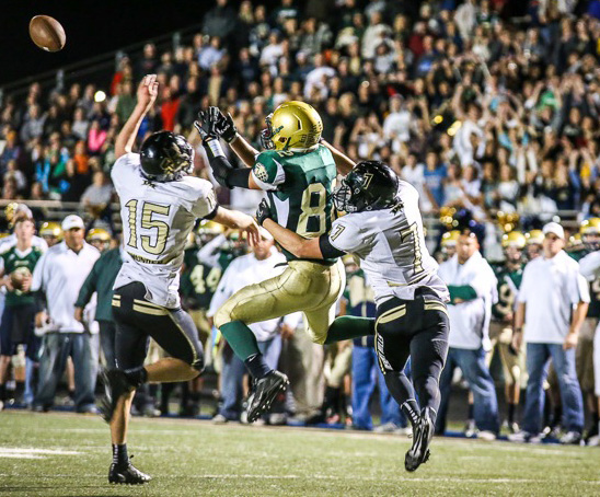 Sil Bundy (15) knocks away a fourth down pass intended for Chance Thorkelson late in the game Wednesday night, Desert Hills at Snow Canyon, St. George, Utah, Oct. 16, 2013 | Photo courtesy Boyd Livingston