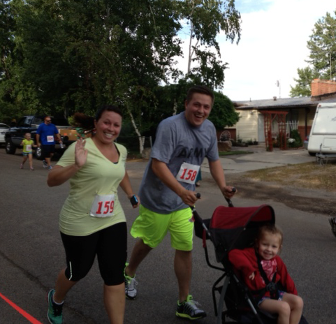 Jordan Bracken pushing his niece in a stroller in a 5K. Bracken will be running the 2013 St. George Marathon with 30 other family members in memoriam of his grandfather, Robert (Bob) Horlacher, St. George, Utah, date and race shown unspecified   Photo courtesy of Jordan Bracken, St. George News