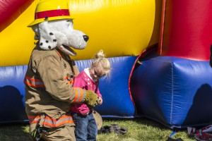 Saiyzha Jimerson gets a hug from Sparky the Safety Dog, Utah State Fire Marshal's mascot, at the Harmony Valley Volunteer Fire Association fundraiser, Apple Harvest Festival, New Harmony, Utah, Oct.12, 2013 | Photo by Jeremy Crawford, St. George News