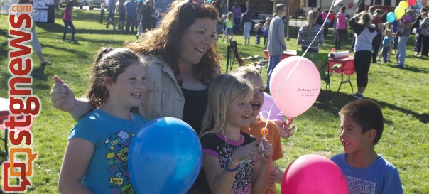 L-R Lizzy, Amy (mother), Megan, Jimmy, and Darren Bates are a family who has been affected by adoption and came out to celebrate with other families in St. George who have also been affected by the impacts of adoption.