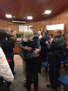 Mayor Dan McArthur hugs his wife, Bunny McArthur during his final city council meeting. St. George city council chambers, Dec. 19, 2013 | Photo courtesy of Nina DeTorres Heck